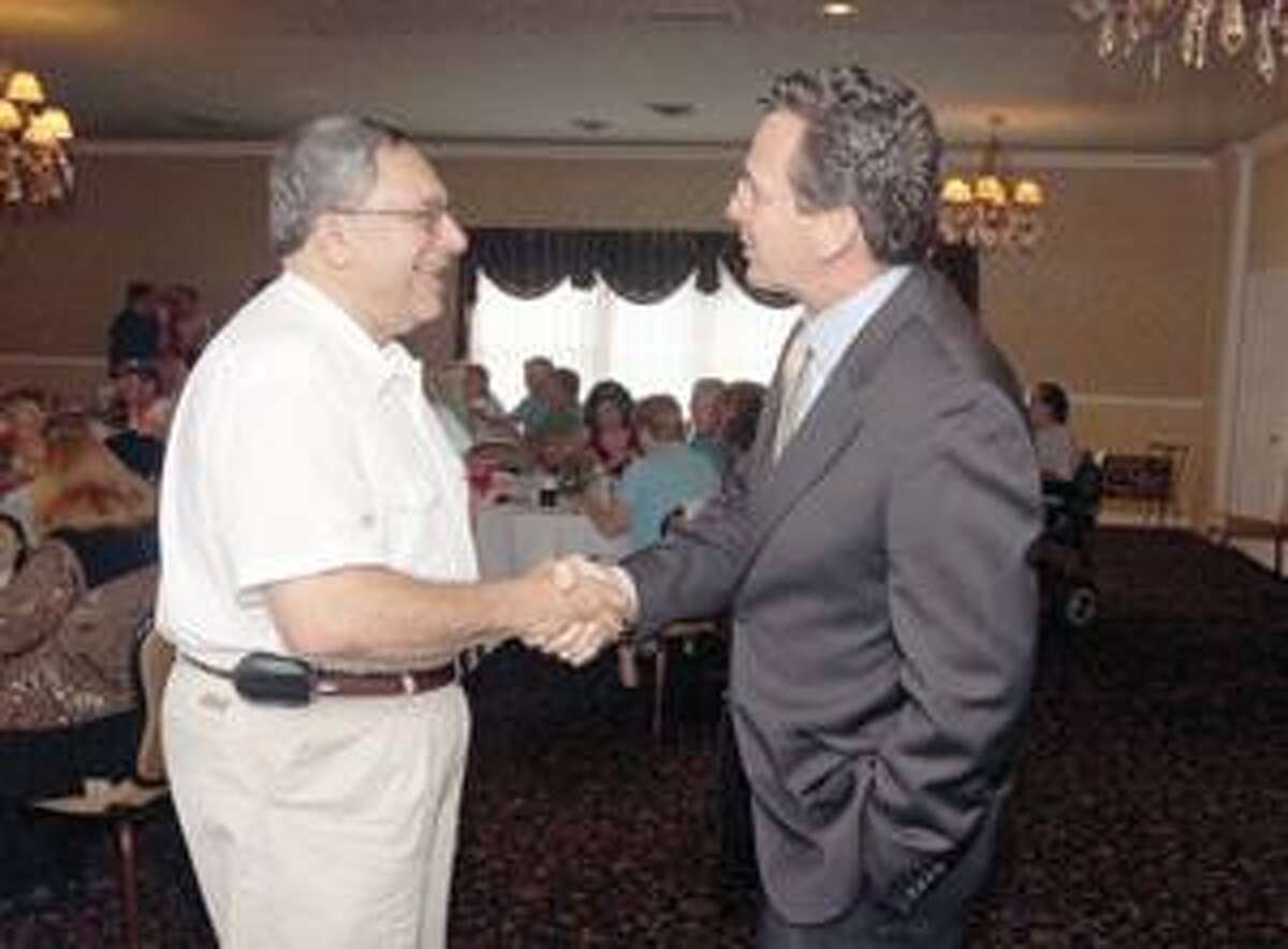 Right, Mayor of Stamford, Dan Malloy, talks with Sam Slaiby during the Democratic gathering held at P. Sam?s in Torrington Thursday.