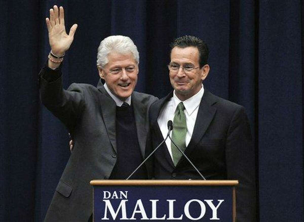 Former President Bill Clinton, left, campaigns for Democratic candidate for governor Dan Malloy, right, at a rally at the University of Hartford in West Hartford, Saturday. Malloy faces Republican Tom Foley in the Nov. 2 election.