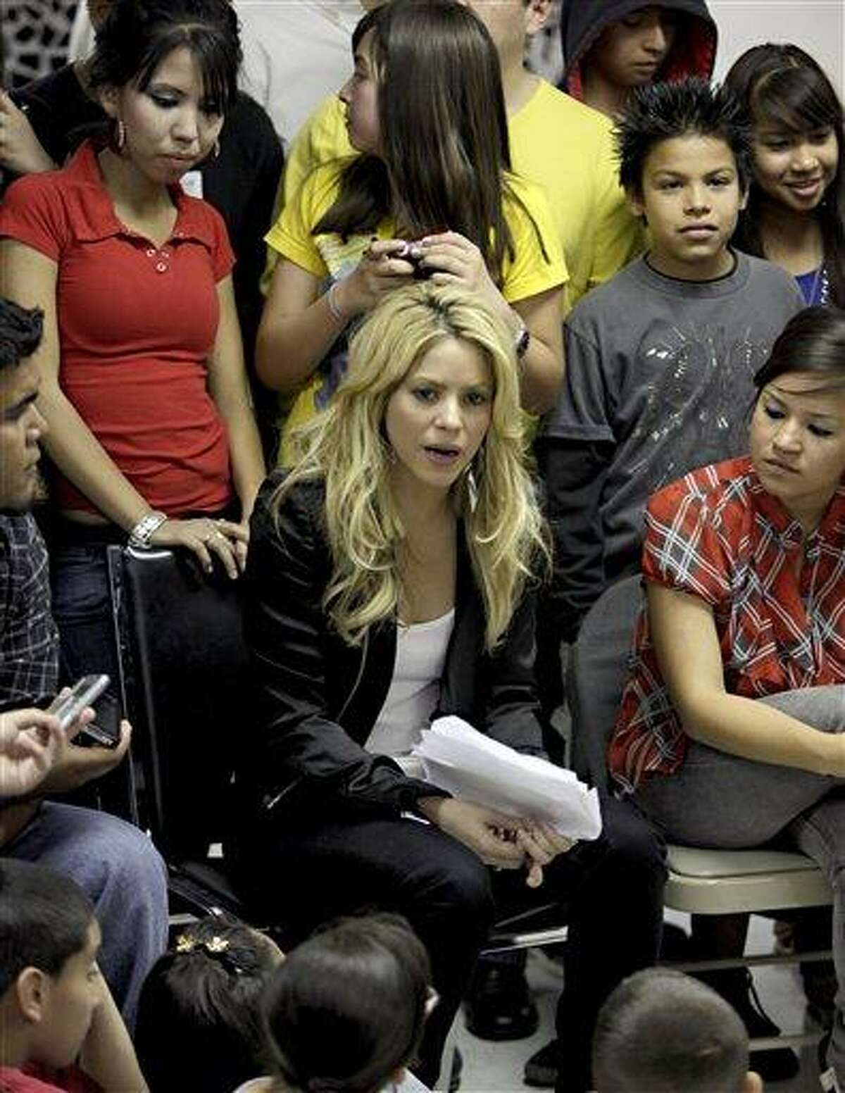 Columbian singer Shakira speaks to guests at the Carl Hayden Youth Center Thursday, April 29, 2010 in Phoenix. The pop star was visiting Phoenix to voice her opposition to the new Arizona immigration law.