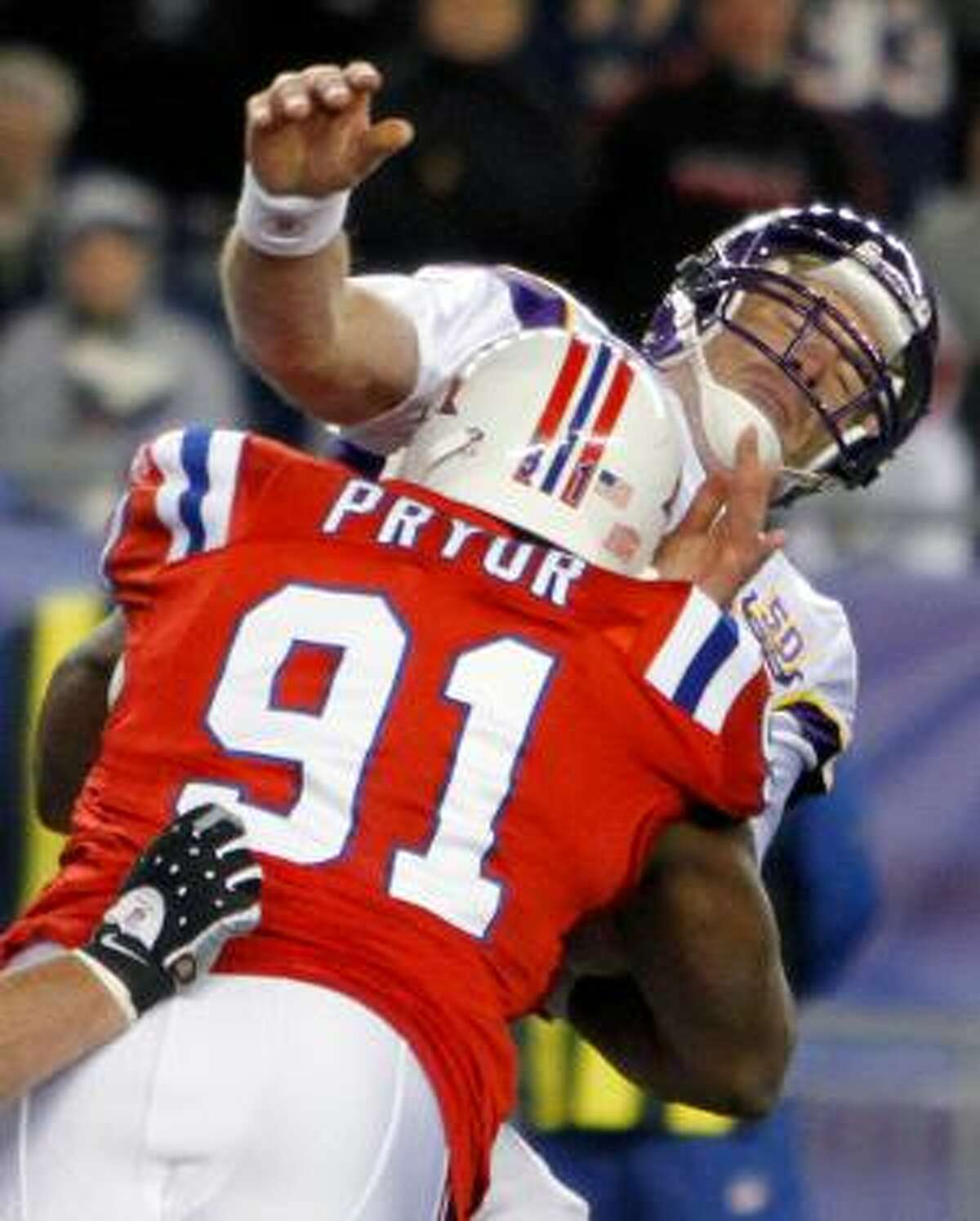 AP New England Patriots defensive tackle Myron Pryor (91) hits Minnesota Vikings quarterback Brett Favre in the fourth quarter of Sunday's game in Foxboro, Mass. Favre was knocked out of the game after sustaining an injury to his chin. He did not return to the game and needed stitches.