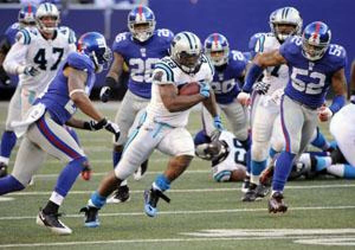 Carolina Panthers running back Jonathan Stewart (28) breaks away from the New York Giants on his way to score a touchdown during the fourth quarter Sunday in East Rutherford, N.J. Stewart rushed for 206 yards in the Panthers' 41-9 win.