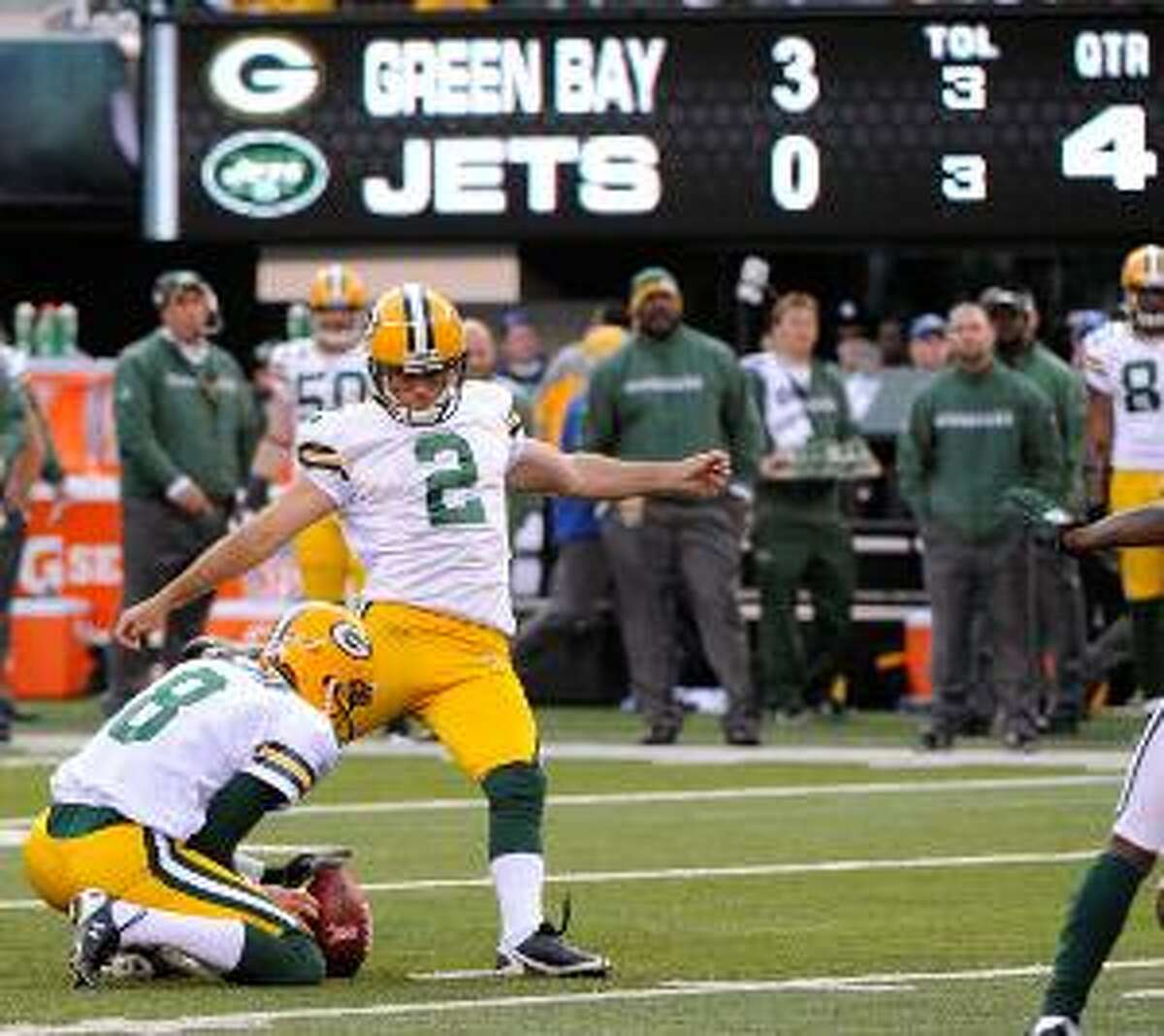 AP Green Bay Packer kicker Mason Crosby (2) boots a field goal during the fourth quarter of Sunday's game against the New York Jets at New Meadowlands Stadium in East Rutherford, N.J. The Packers won 9-0. (AP Photo/Bill Kostroun)