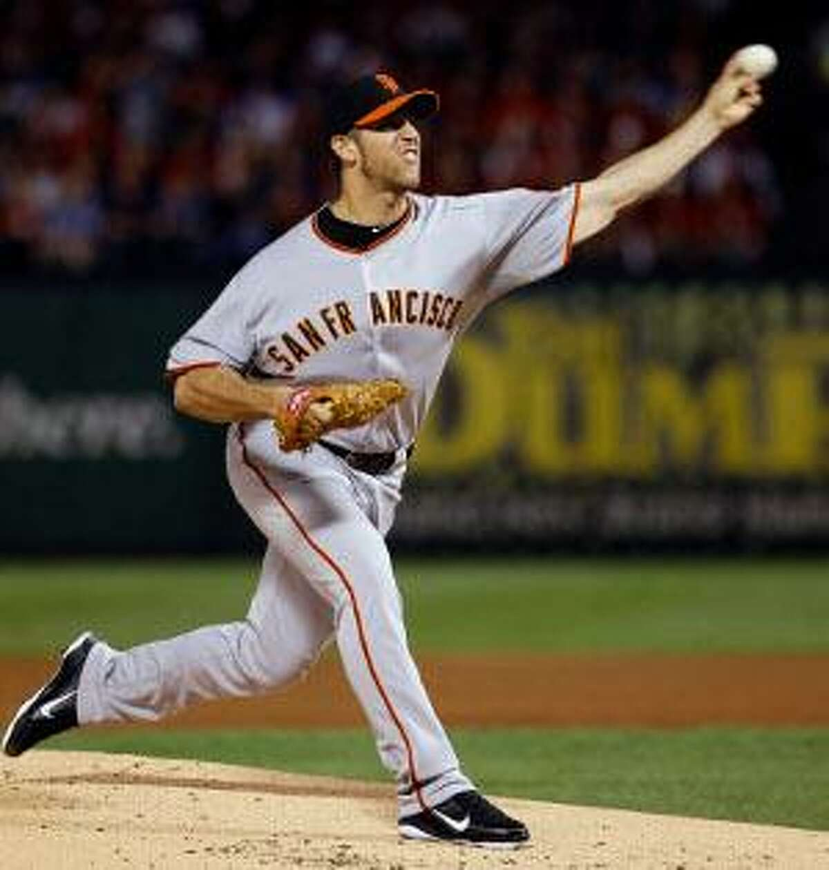 San Francisco Giants starting pitcher Madison Bumgarner throws during the first inning of Game 4 of the World Series against the Texas Rangers Sunday, in Arlington, Texas. (AP Photo/Matt Slocum)