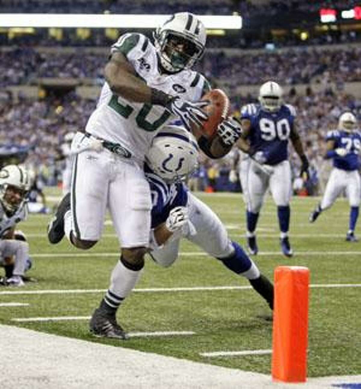 New York Jets running back Thomas Jones, left, is pushed out of bounds by Indianapolis Colts cornerback Jamie Silva during the fourth quarter Sunday in Indianapolis. The Jets defeated the Colts 29-15.
