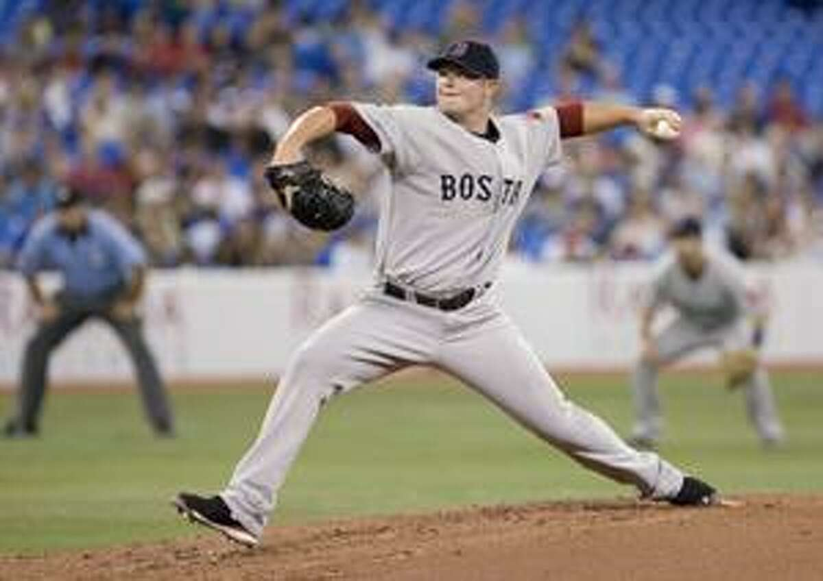 AP Boston Red Sox pitcher Jon Lester works against the Toronto Blue Jays during the second inning of a game in Toronto on Thursday.