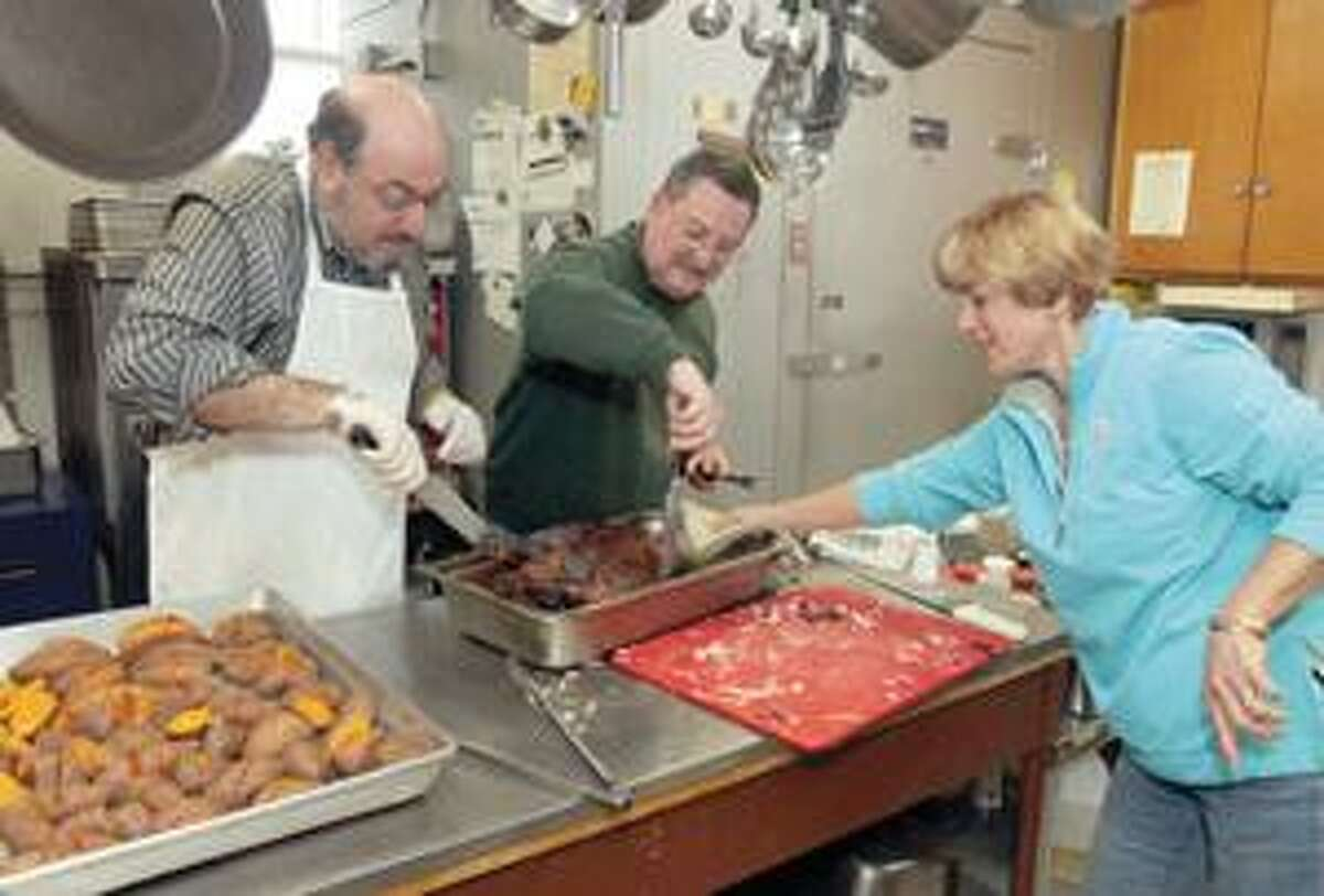 Left, Ed Arum, Alan Matisoff and Susan Levine prepare lunch at the Torrington Community Soup Kitchen Christmas Day.