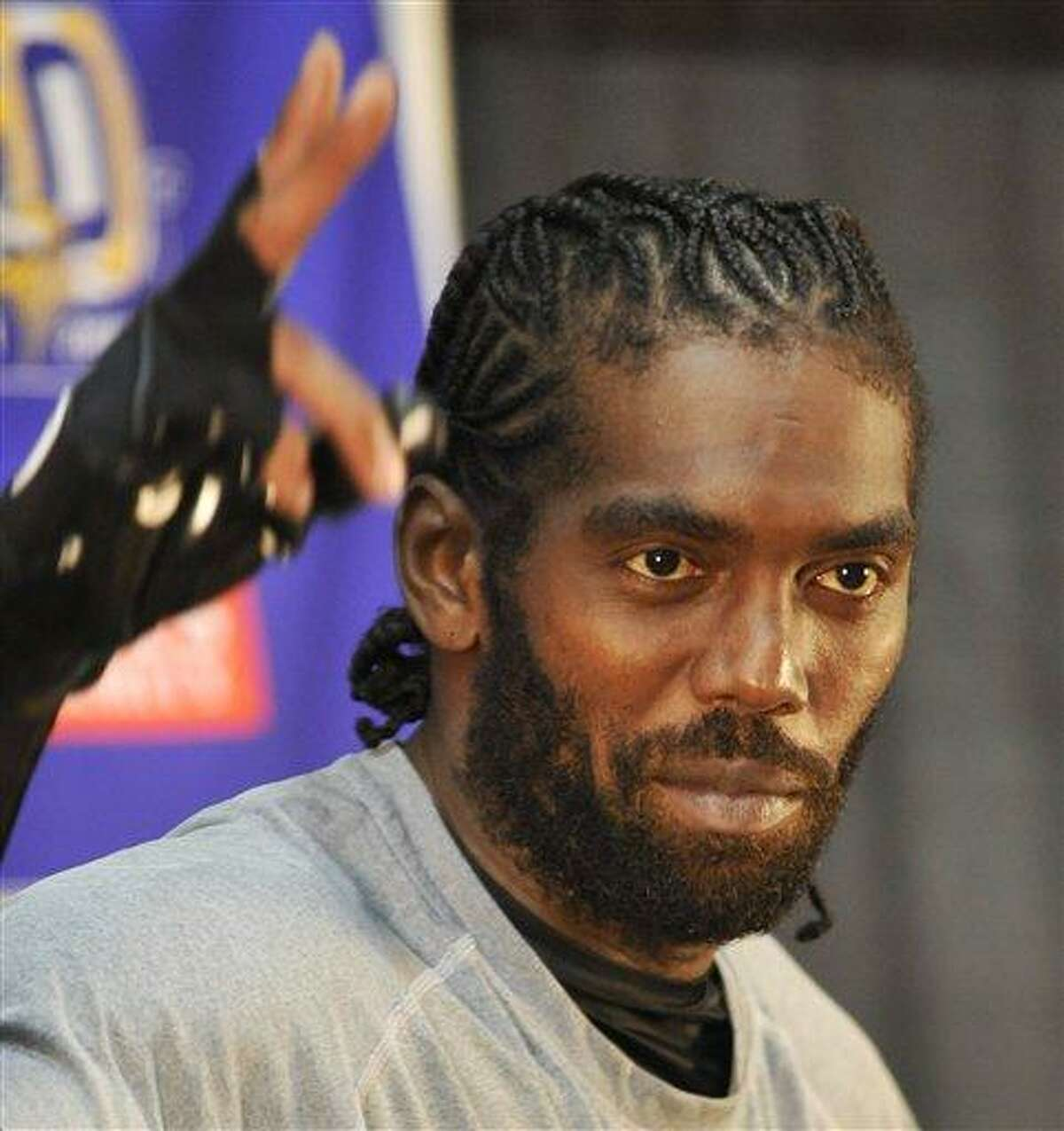 Minnesota Vikings new wide receiver Randy Moss answers a question at a news conference Thursday, Oct. 7, 2010 in Eden Prairie, Minn. Moss was traded Wednesday to the Vikings from the New England Patriots. (AP Photo/Jim Mone)