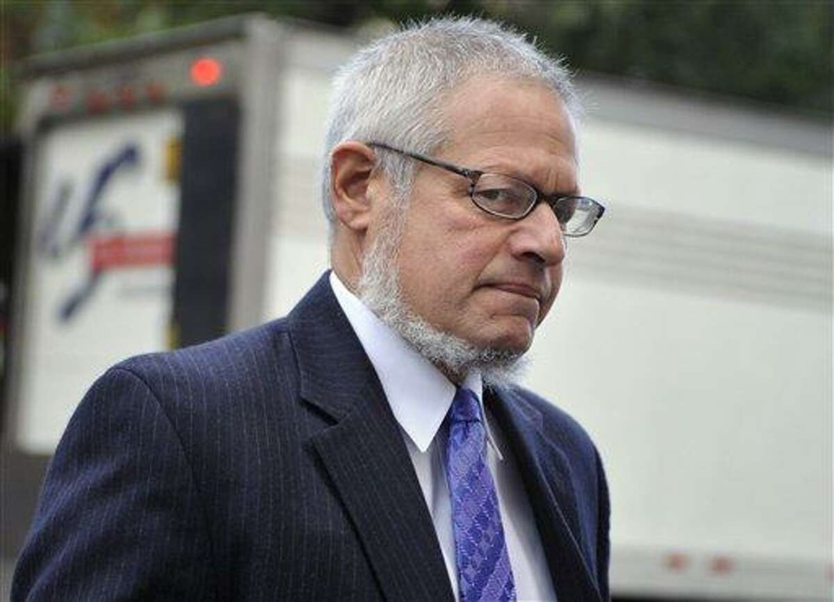 Attorney Thomas Ullmann, Public Defender for Steven Hayes, arrives at Superior Court for the first day of the penalty phase of the trial of 47-year-old Steven Hayes in New Haven, Conn., on Monday, Oct. 18, 2010. Hayes was convicted of 16 counts for the 2007 killings in Cheshire. (AP Photo/Jessica Hill)