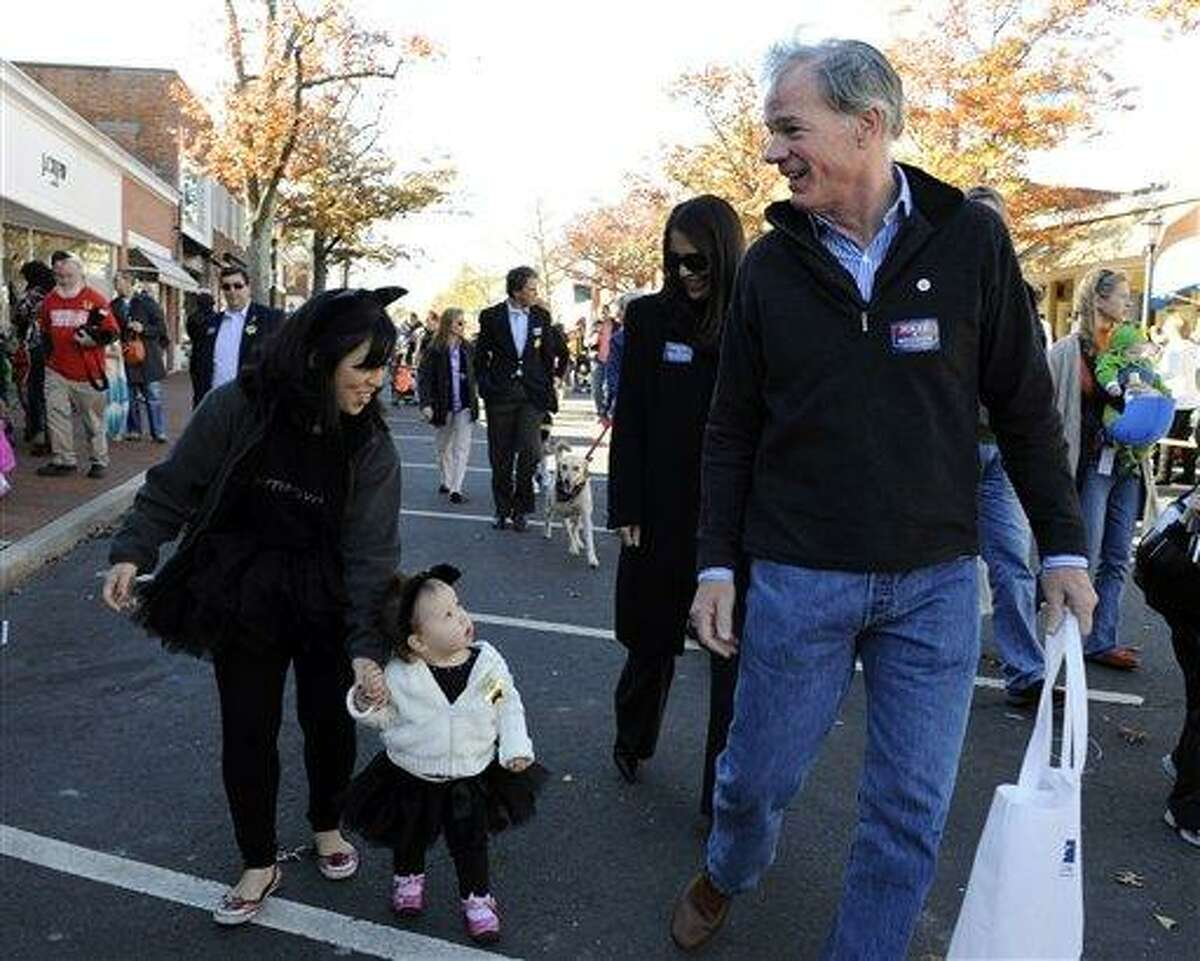 Connecticut Republican gubernatorial candidate Tom Foley, says hello to parade goers at a Halloween parade in New Canaan, Conn., on Sunday, Oct. 31, 2010. (AP Photo/Fred Beckham)