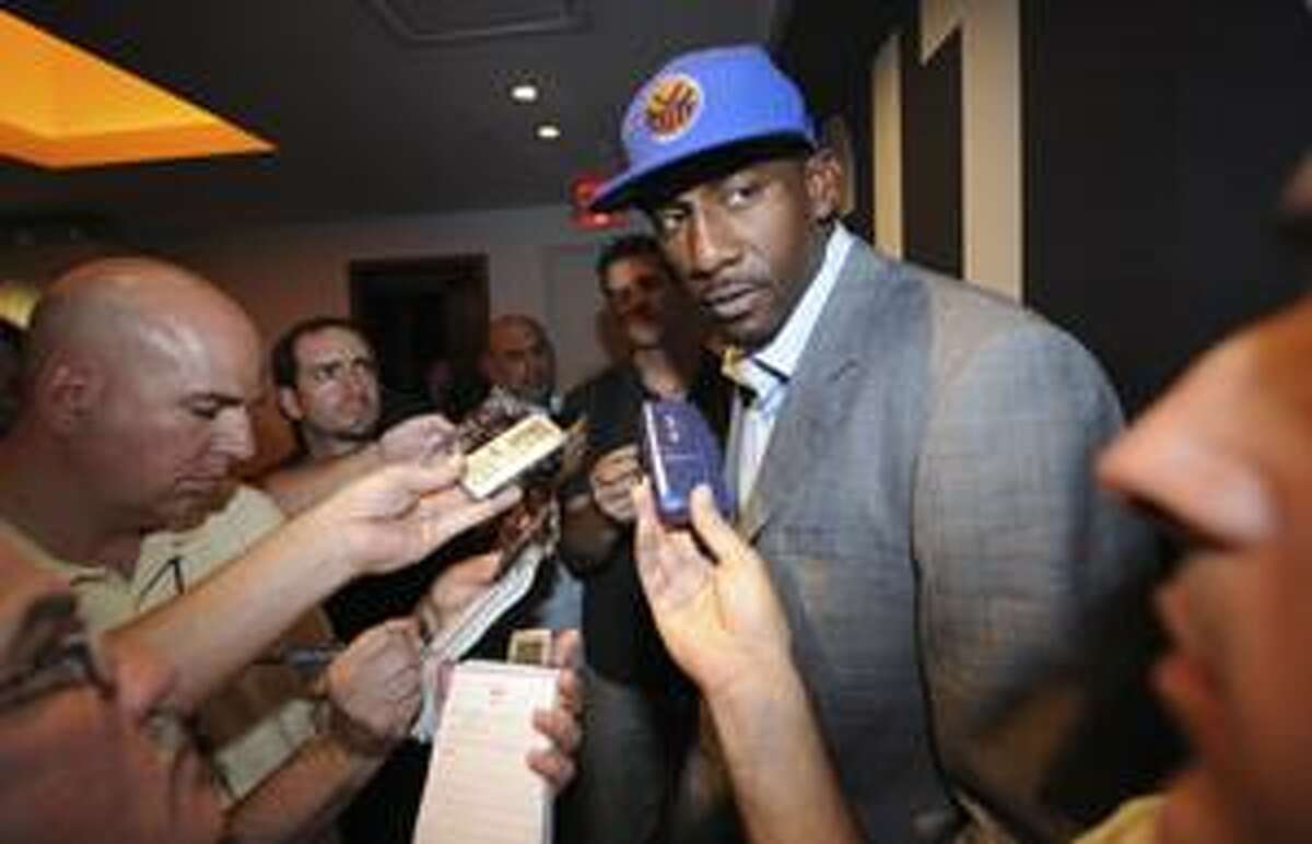 Amare Stoudemire is interviewed inside Madison Square Garden on Monday, July 5, 2010, in New York. Stoudemire is headed to the New York Knicks, and both sides are hoping he's not coming alone. The Knicks said Monday they intend to sign Stoudemire to a contract later this week when the free agent moratorium period ends. Stoudemire's agent, Happy Walters, said the deal is for the maximum allowed, which would be nearly $100 million over five years. (AP Photo/ Louis Lanzano)