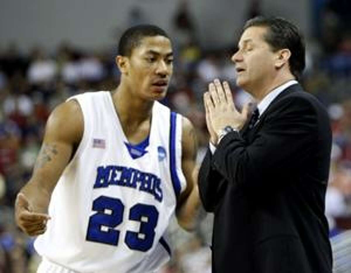 AP This is a March 23, 2008, file photo showing Memphis coach John Calipari talking to Memphis guard Derrick Rose (23) during a time out in the first half of an NCAA tournament against Mississippi State in North Little Rock, Ark. Memphis will be forced to vacate the record 38 victories from its Final Four season of 2007-08, according to a report by the Memphis Commercial Appeal.