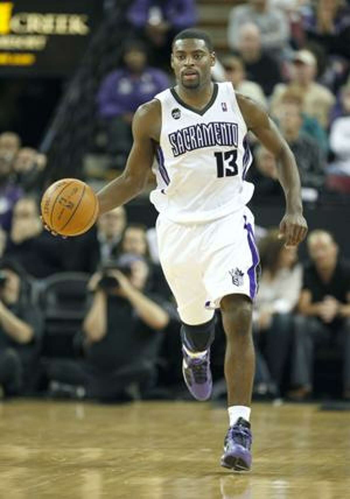 AP This April 12, file photo shows Sacramento Kings guard Tyreke Evans bringing the ball up court against the Houston Rockets during the second half of a game in Sacramento, Calif. Evans beat out Golden State's Stephen Curry and Milwaukee's Brandon Jennings to win the NBA Rookie of the Year award, Thursday.