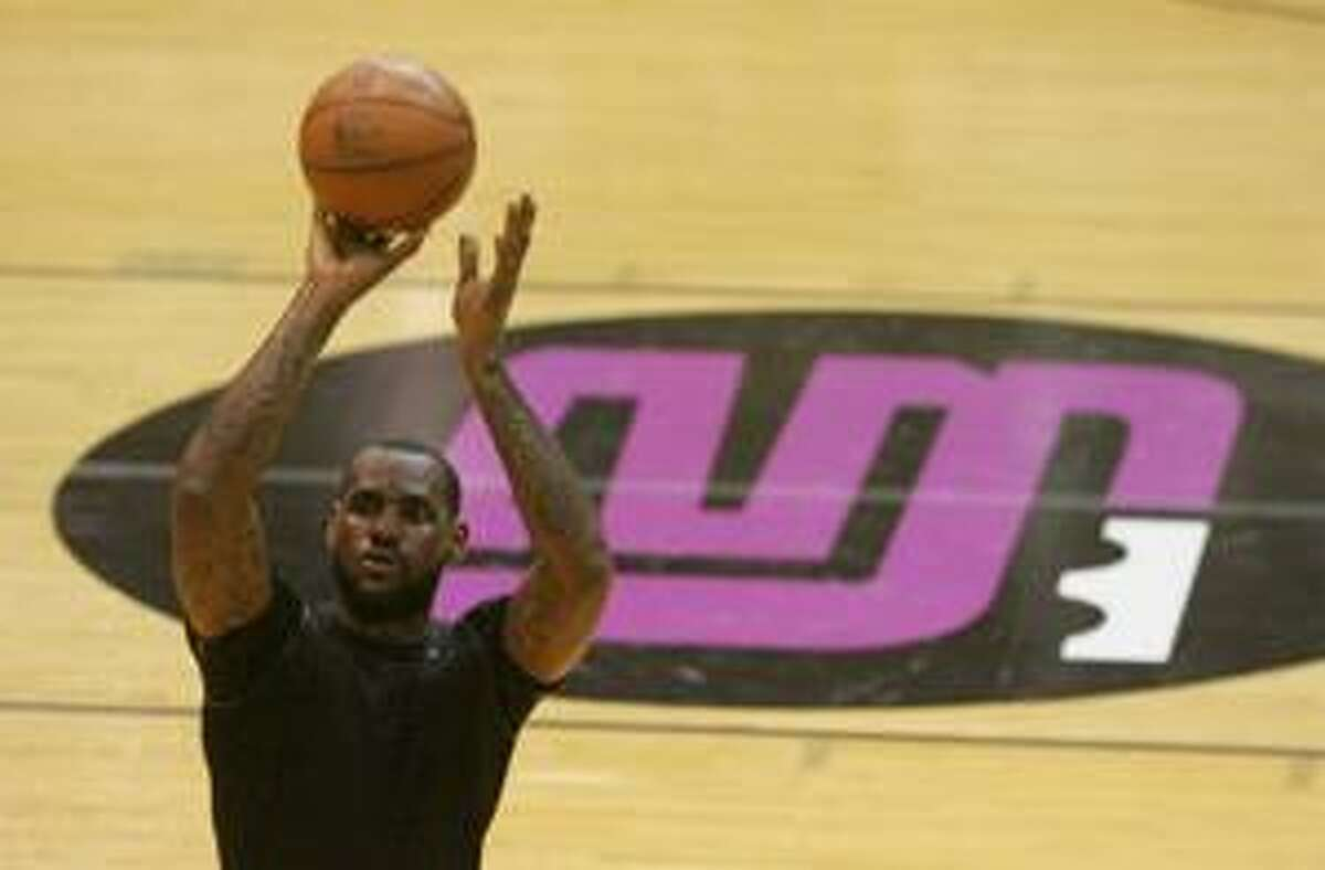 Cleveland Cavalier free agent LeBron James makes a shot during the LeBron James Skills Academy at the James A. Rhodes Arena on the University of Akron campus Monday, July 5, 2010 in Akron, Ohio. James is not expected to say which team he'll choose until the camp ends Wednesday. Last week, James heard presentations from the Cavs, Nets, Knicks, Heat, Clippers and Bulls. AP Photo/Akron Beacon Journal, Karen Schiely)