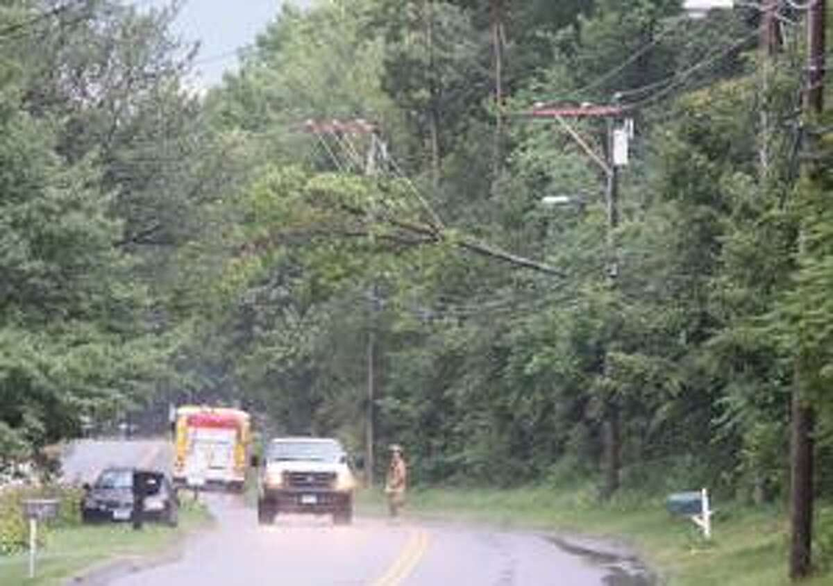 SONJA ZINKE/Register CitizenTorringford Volunteer Fire Department secured the scene along Torringford West Street in Torrington after Friday's storm brought a large tree down on the wires. Purchase a glossy print of this photo and more at www.registercitizen.com