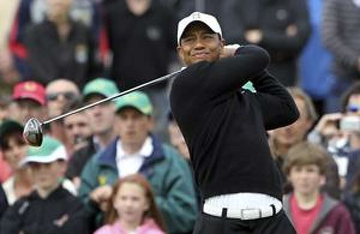 Tiger Woods tees off on the 2nd hole during the JP MC Manus Invitational Pro-Am at Adare Manor, Limerick, Ireland, Monday, July, 5, 2010. Woods is preparing for next week's British Open at St. Andrews and could lose the top ranking for the first time in five years before then. Every five years, Irish horse racing billionaire McManus brings together mixed groups of pros, Irish business leaders and Hollywood celebrities for an event expected to raise more than $37 million for dozens of Irish charities. (AP Photo/Peter Morrison)