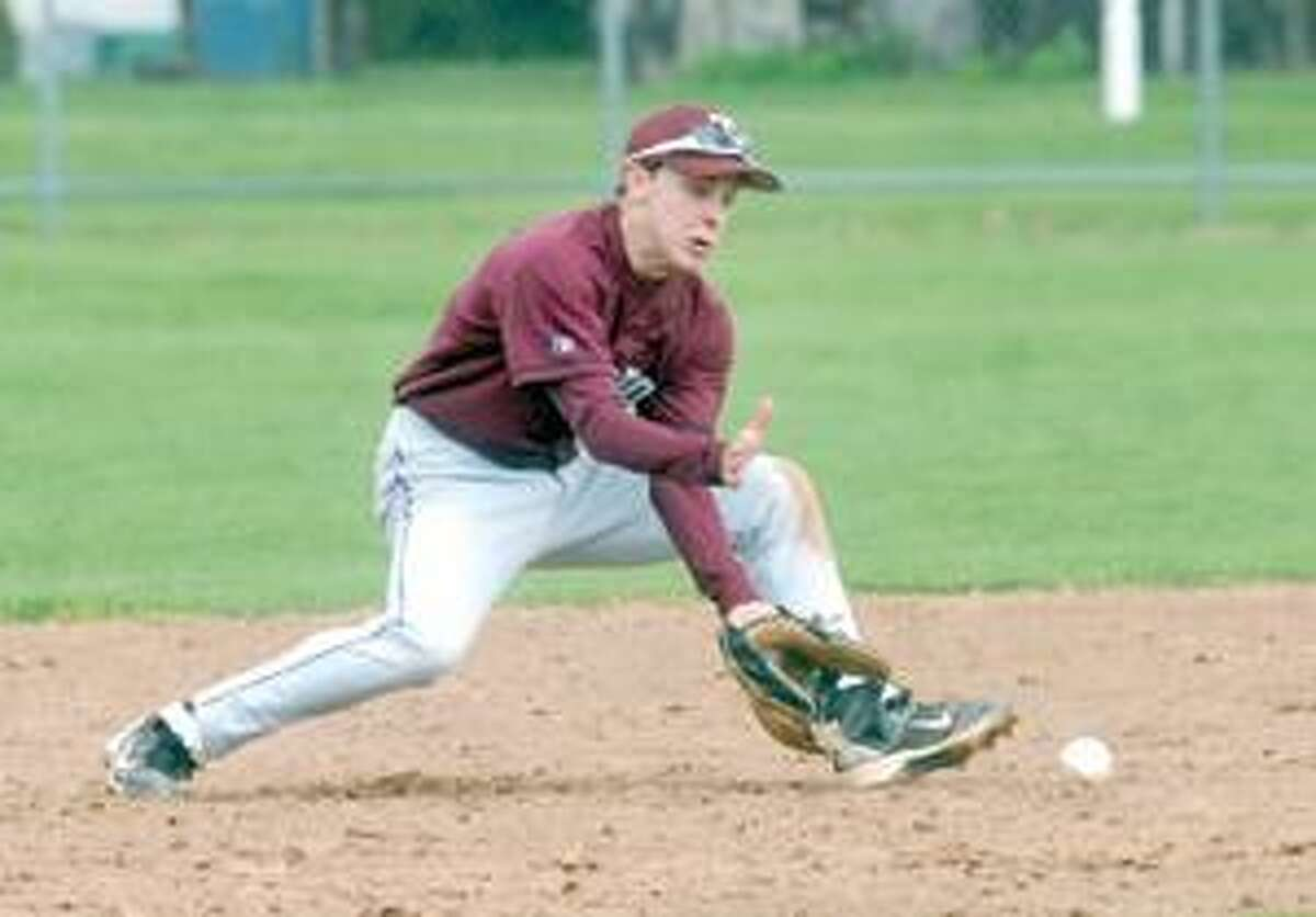 MIC NICOSIA/Register Citizen Torrington's Bryan Failla eyes a ground ball before turning a double play during Wednesday's game with Wilby at Fuessenich Park. Purchase a glossy print of this photo and more at www.registercitizen.com.