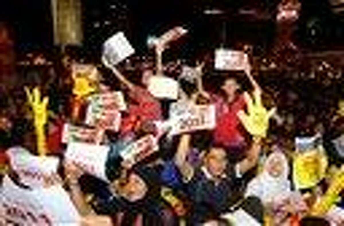 Malaysian people hold placards reading