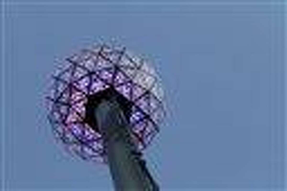 The New Year's Eve ball is lit at the top of the a 141 foot flagpole on top of One Times Square during a test run, Thursday, Dec. 30, 2010 in New York. The ball is powered by 32,256 Philips Luxeon LEDs and covered in 2,688 Waterford Crystals. (AP Photo/Mary Altaffer)
