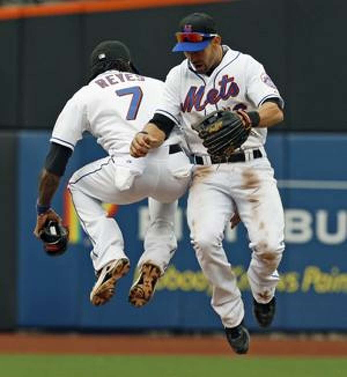 New York Mets' Jose Reyes, left, and Angel Pagan celebrate the Mets 7-3 victory over the Los Angeles Dodgers in a baseball game at Citi Field in New York, Wednesday, April 28, 2010. (AP Photo/Kathy Willens)