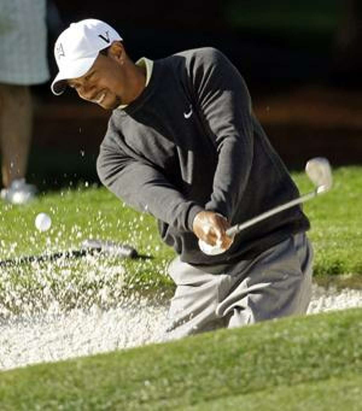Tiger Woods hits from a sand trap on the sixth hole during the pro-am of the Quail Hollow Championship golf tournament at Quail Hollow Club in Charlotte, N.C., Wednesday, April 28, 2010. (AP Photo/Chuck Burton)
