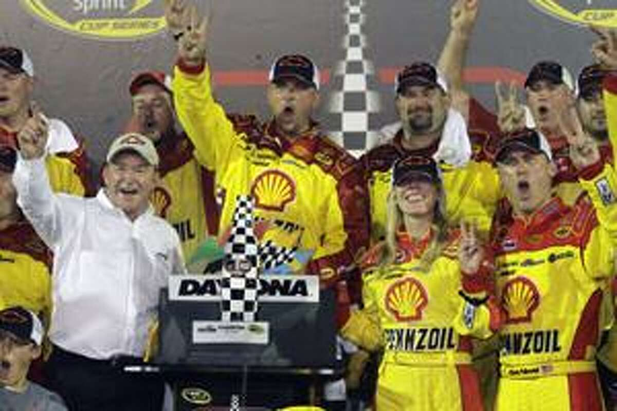 Car owner Richard Childress, lower left, driver Kevin Harvick, front right, and his wife DeLana, second from right, celebrate with crew members after winning the Coke Zero 400 auto race at Daytona International Speedway in Daytona Beach, Fla., Sunday, July 4, 2010. (AP Photo/Terry Renna)