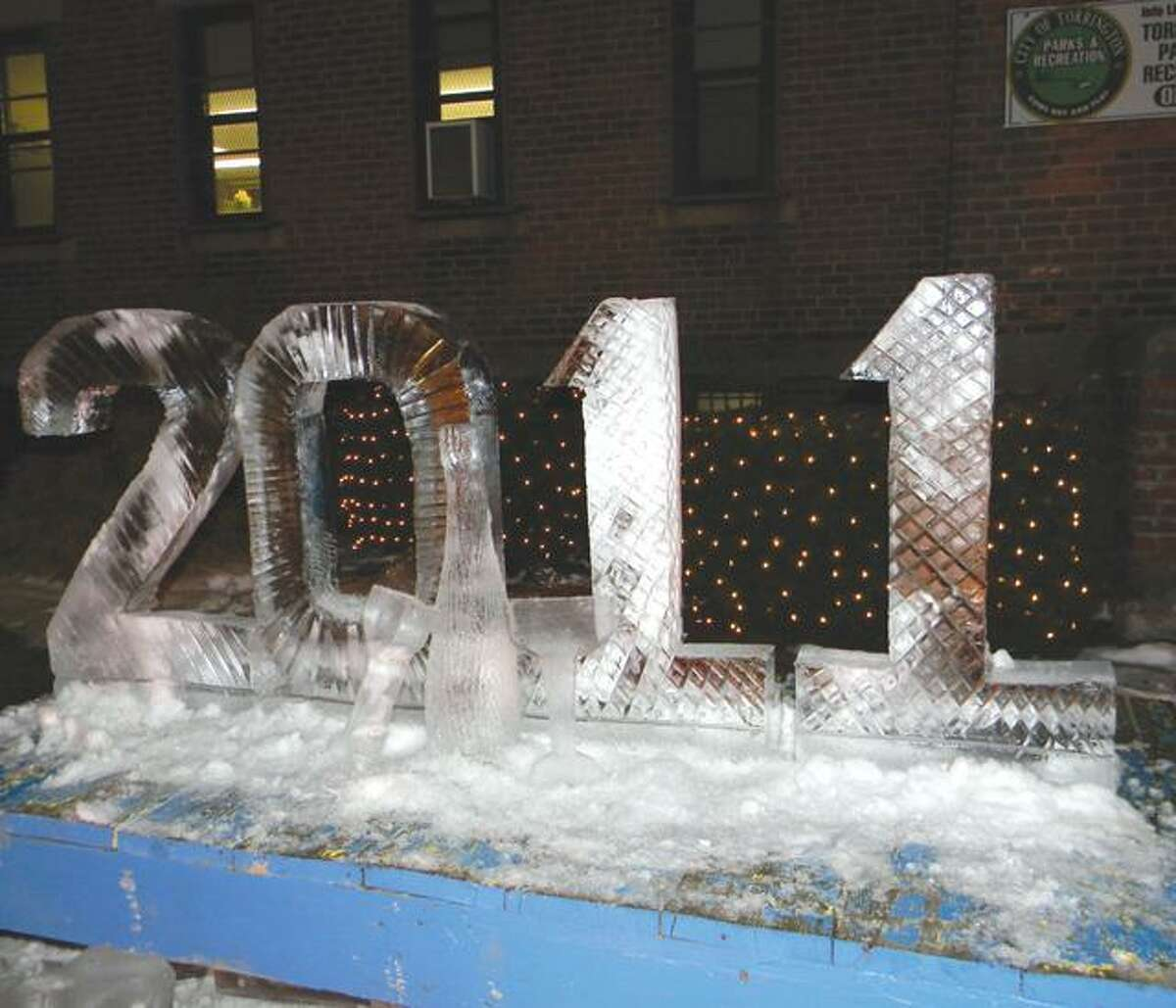 MIKE AGOGLIATI/ Register Citizen An ice sculpture welcomed guests to Torrington's Last Night on Friday.