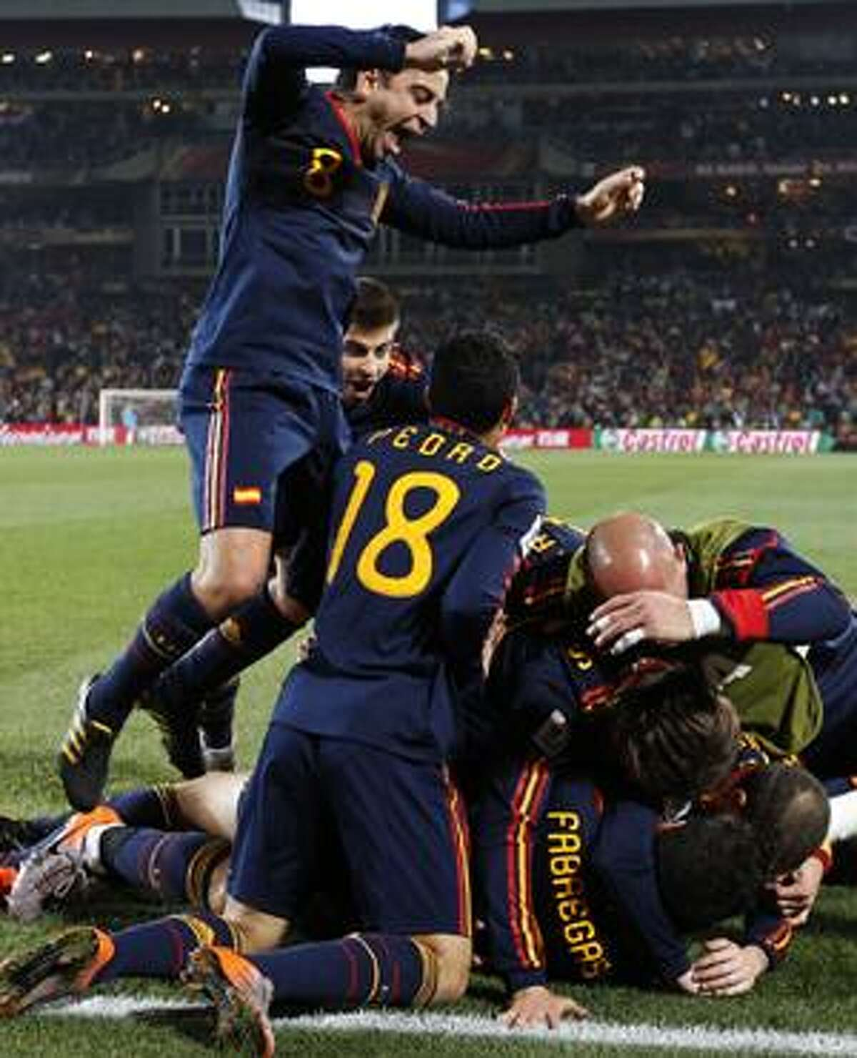 Spain players celebrate with Spain's David Villa, not visible, after he scored a goal during the World Cup quarterfinal soccer match between Paraguay and Spain at Ellis Park Stadium in Johannesburg, South Africa, Saturday, July 3, 2010. (AP Photo/Bernat Armague)