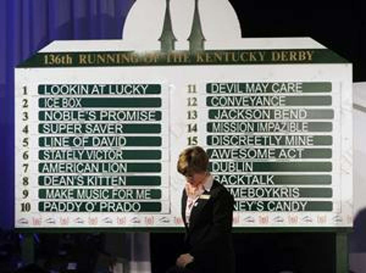 Julianna Oxley walks away from the post position board after the field was set for the Kentucky Derby at Churchill Downs in Louisville, Ky., Wednesday, April 28, 2010. (AP Photo/Ed Reinke)