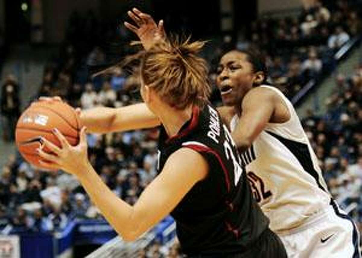 Connecticut's Kalana Greene defends against Stanford's Jeanette Pohlen during the first half Wednesday in Hartford.