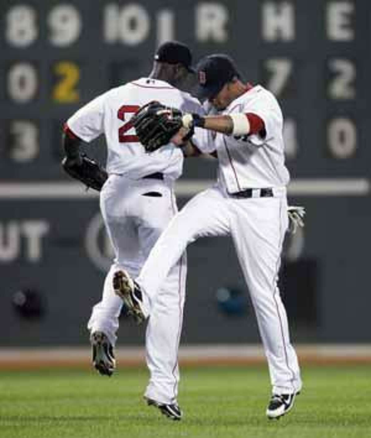 Boston Red Sox's Mike Cameron, left, and Darnell McDonald celebrate their 9-3 win in a baseball game against the Baltimore Orioles, Saturday, July 3, 2010, in Boston. (AP Photo/Michael Dwyer)