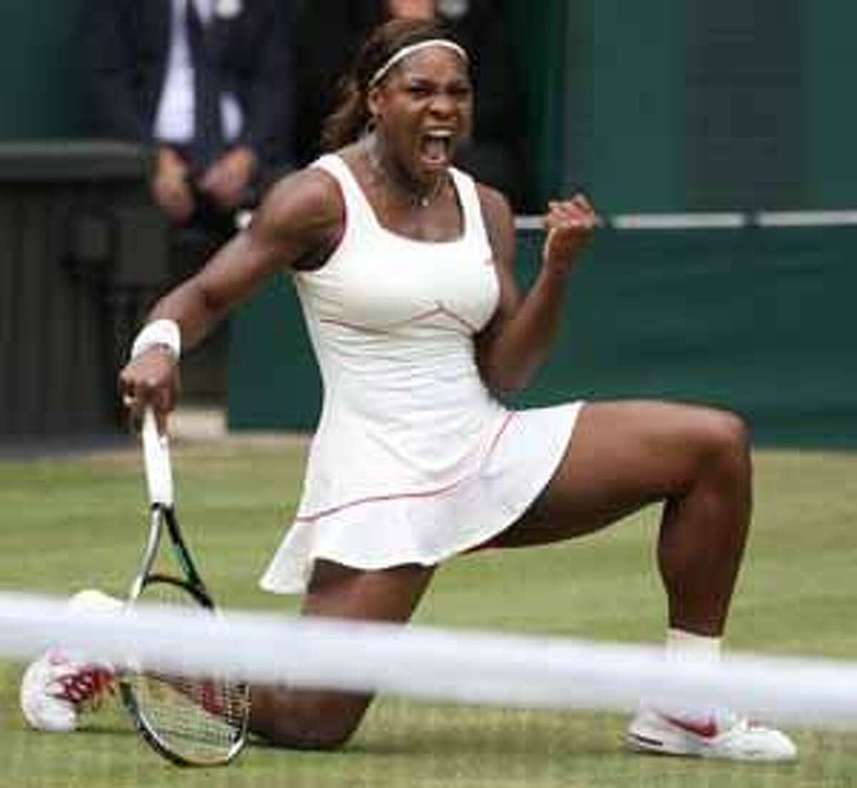 Defending champion Serena Williams reacts as she wins a point from Vera Zonareva, during the women's singles final on the Centre Court at the All England Lawn Tennis Championships at Wimbledon, Saturday, July 3, 2010. (AP Photo/Jon Super)