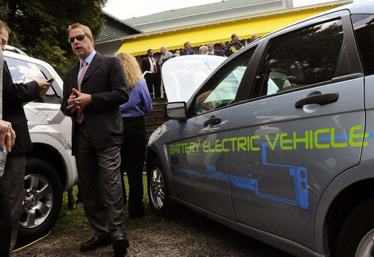 Ford Motor Co. Chairman Bill Ford is interviewed with a Ford Focus Battery Electric Vehicle during the 2009 Mackinac Policy Conference in Mackinac Island, Mich. Ford Motor Co. on Tuesday, Aug. 18 said its future electric cars will