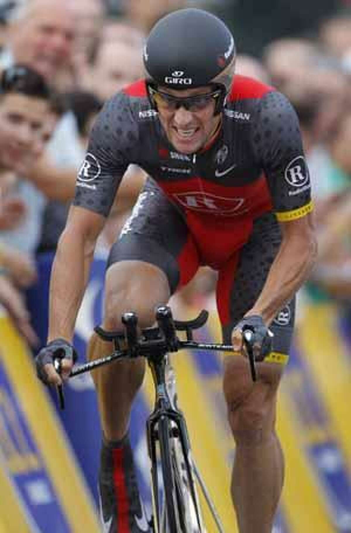 Seven-time Tour de France winner Lance Armstrong strains to take a fourth place during the prologue of the Tour de France cycling race, an individual time trial over 8,9 kilometers (5.5 miles) in the port city of Rotterdam, Netherlands, Saturday July 3, 2010. (AP Photo/Laurent Rebours)