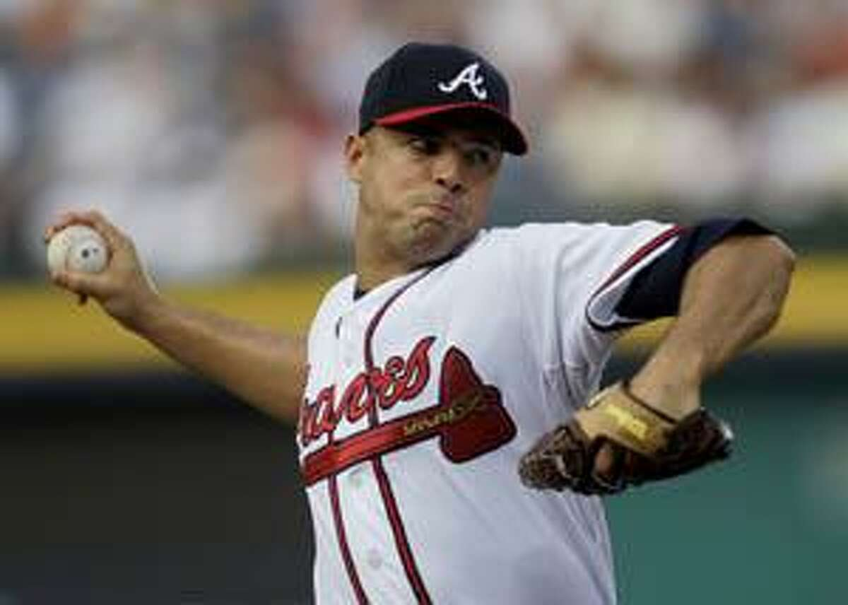 AP Atlanta Braves starter Javier Vazquez works in the first inning of a July 2 game against the Philadelphia Phillies in Atlanta. Vazquez was traded back to the Yankees by the Atlanta Braves on Tuesday for outfielder Melky Cabrera, a move that pushed New York's payroll for next season over $200 million.