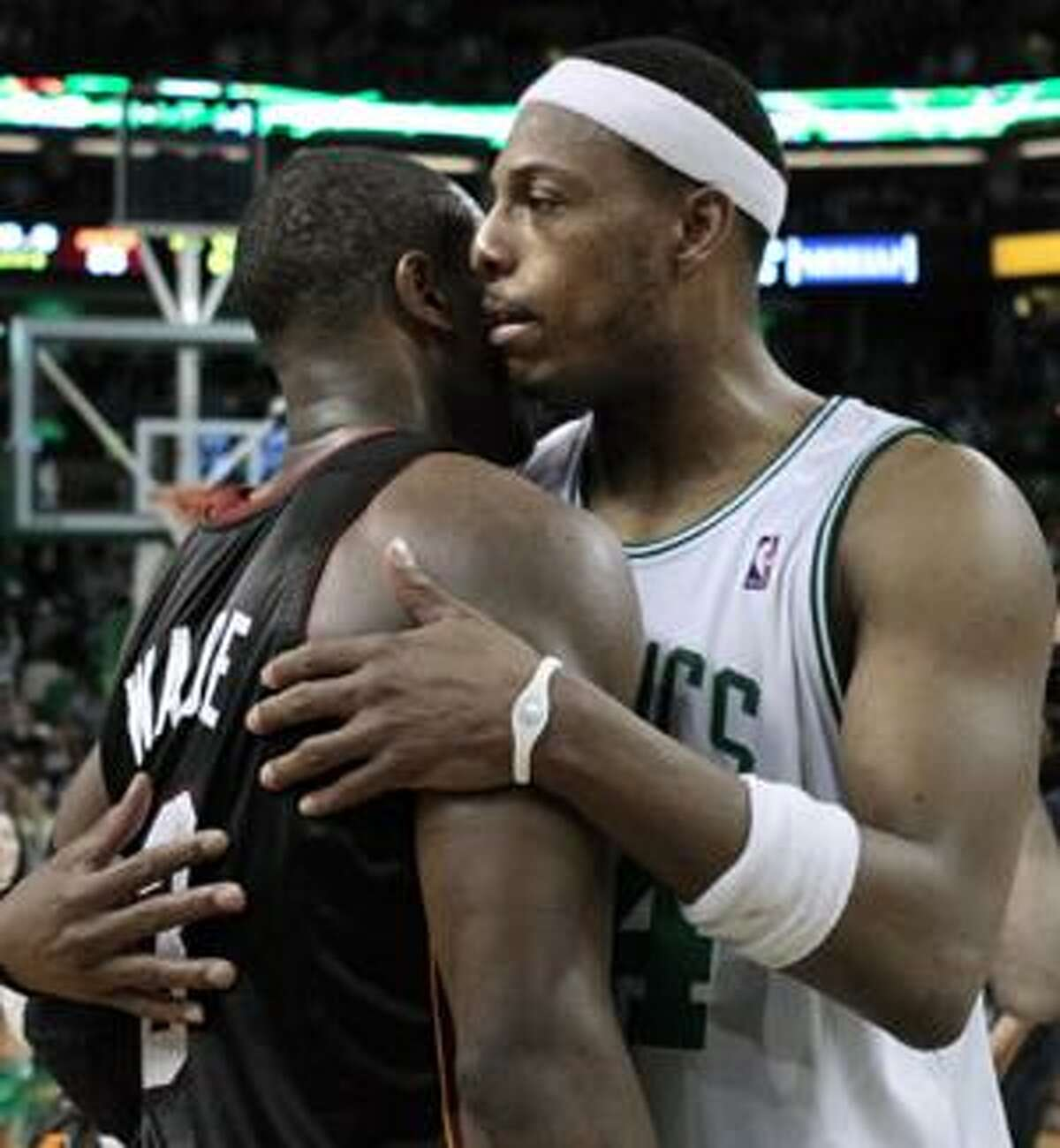Boston Celtics forward Paul Pierce, right, embraces Miami Heat guard Dwyane Wade after the Celtics' 96-86 victory in Game 5 to win the first-round NBA basketball series, in Boston on Tuesday, April 27, 2010. (AP Photo/Elise Amendola)