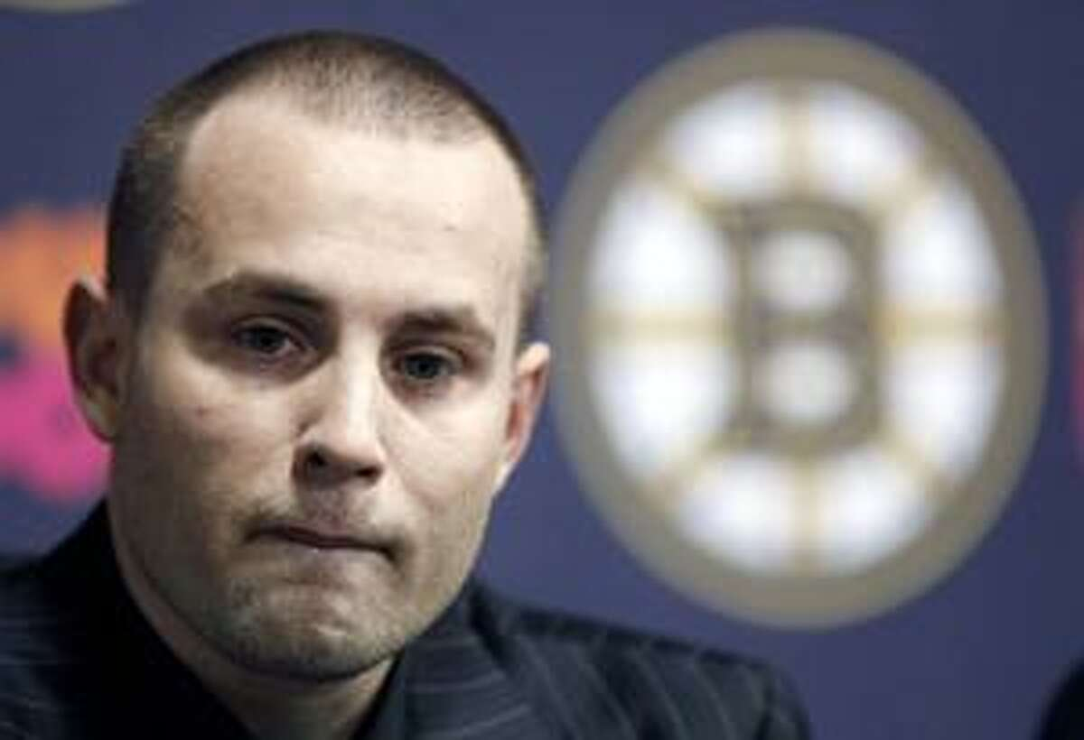 FILE - In this March 27, 2010, file photo, Boston Bruins' Marc Savard talks about his injury during a hockey news conference in Boston. Bruins general manager Peter Chiarelli says center Marc Savard has been cleared to play and will be available for the team's second-round playoff series. (AP Photo/Michael Dwyer, File)