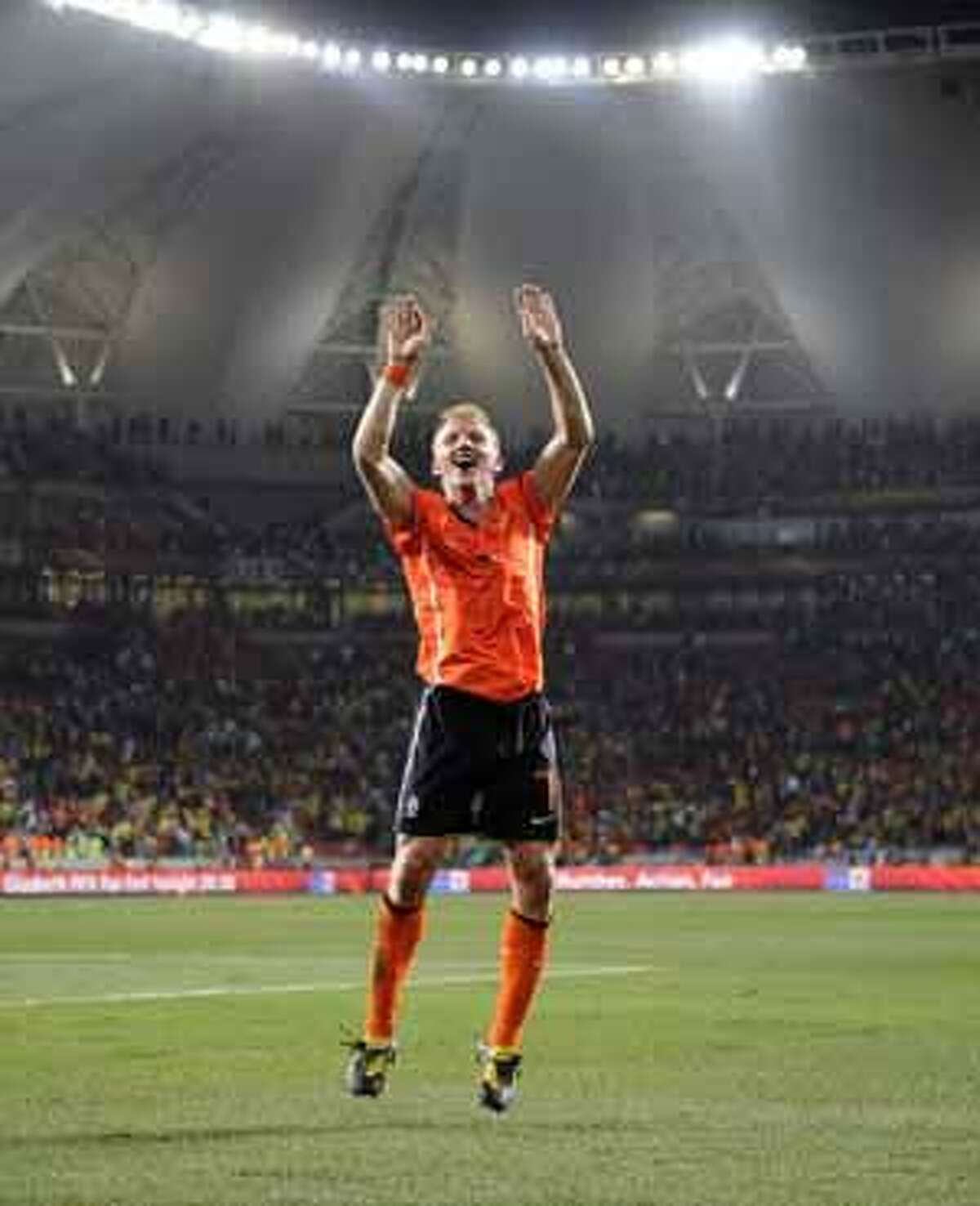 Netherlands' Dirk Kuyt celebrates following the World Cup quarterfinal soccer match between the Netherlands and Brazil at Nelson Mandela Bay Stadium in Port Elizabeth, South Africa, Friday, July 2, 2010. Netherlands defeated Brazil 2-1 on Friday, becoming the first semifinalist of the World Cup. (AP Photo/Martin Meissner)