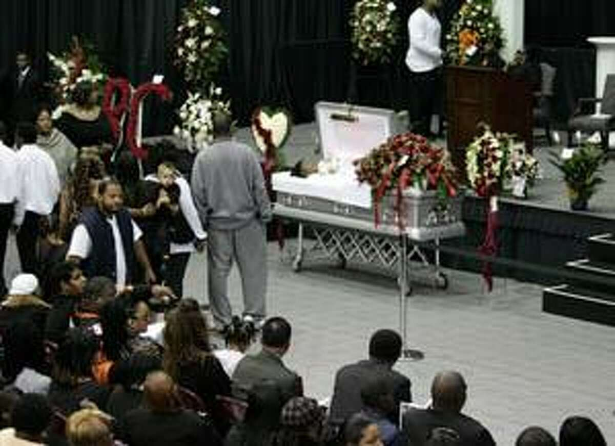 AP Mourners gather before a memorial service for Cincinnati Bengals wide receiver Chris Henry in Westwego, La., Tuesday. Henry, who grew up in nearby Belle Chasse, died on Dec. 17, after falling out of the back of a pickup truck driven by his fiancee, Loleini Tonga.