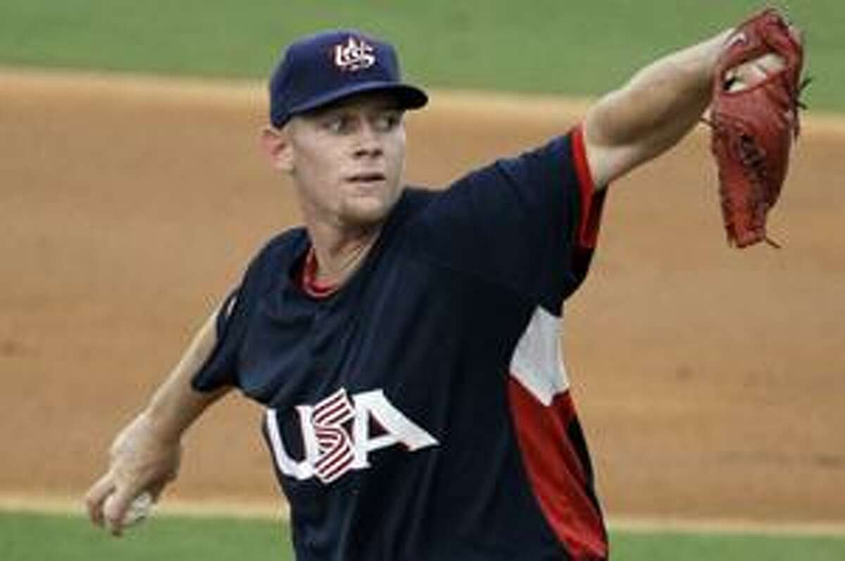AP In this Aug. 22, 2008, file photo, USA starting pitcher Stephen Strasburg throws against Cuba in their semifinal at the 2008 Olympics in Beijing. The Washington Nationals knew they needed to sign Strasburg, the No. 1 overall draft pick, and they did.