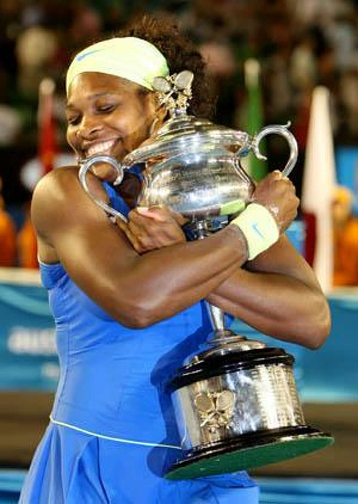 AP Serena Williams of the United States holds the trophy after beating Russia's Dinara Safina during the women's singles final at the Australian Open Tennis Championship in Melbourne, Australia, on Jan. 31. Williams was chosen as AP Female Athlete of Year for the second time on Tuesday.