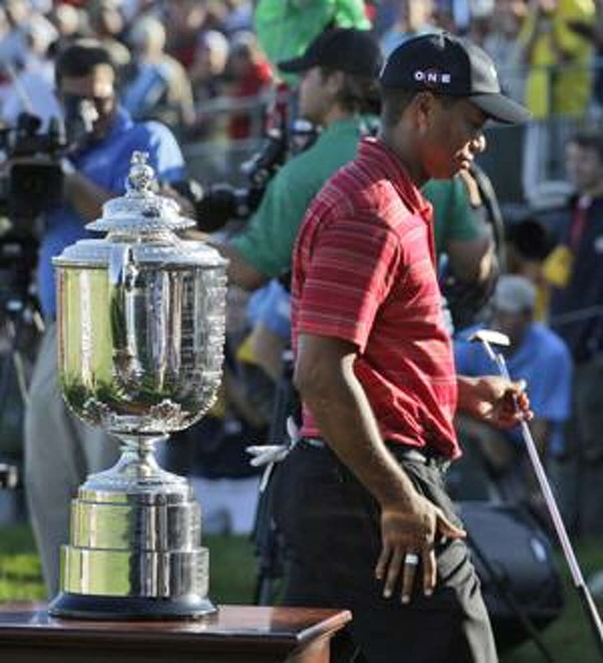 AP Tiger Woods walks past the Wanamaker Trophy after losing to Y.E. Yang, of South Korea, at the 91st PGA Championship at the Hazeltine National Golf Club in Chaska, Minn., Sunday.