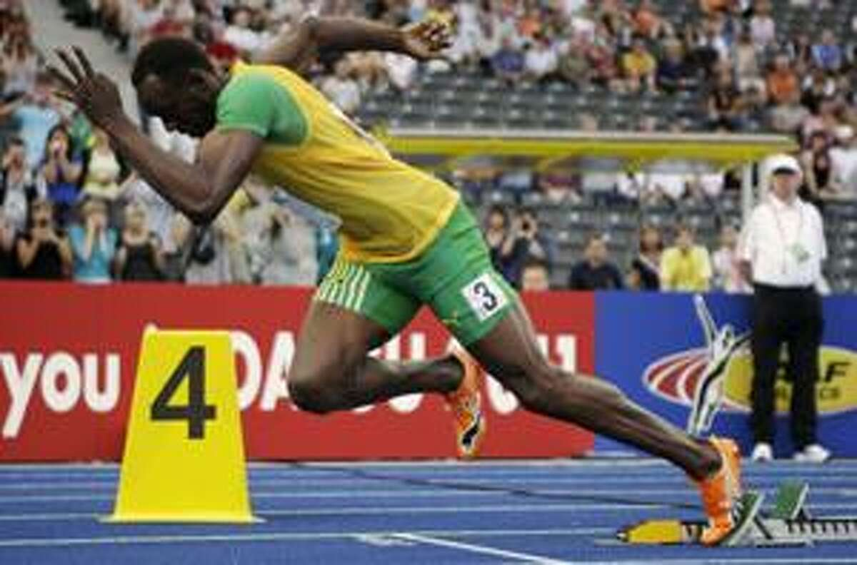 AP Jamaica's Usain Bolt starts a Men's 200 meter second round heat during the World Athletics Championships in Berlin on Tuesday.