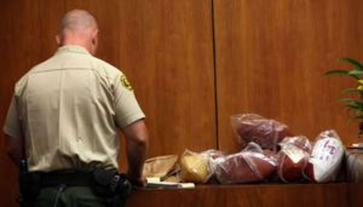 AP A Los Angeles County Sheriff's deputy arranges footballs seized during a hotel heist that landed O.J. Simpson in jail during a hearing Tuesday in Santa Monica, Calif., to consider ownership of O.J. Simpson items seized by authorities.