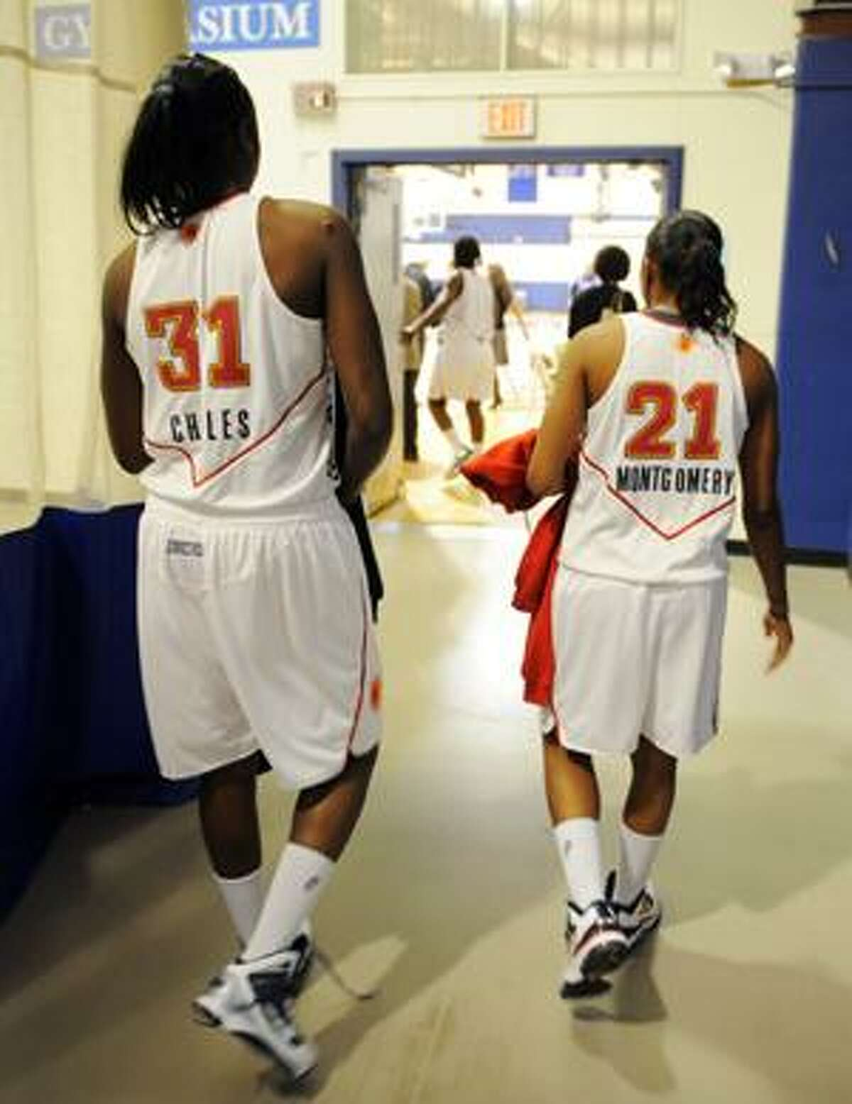 Former University of Connecticut teammates Tina Charles, left, and Renee Montgomery arrive for the opening of training camp for the 2010 Connecticut Sun season on Monday, April 26, 2010 in New London, Conn. (AP Photo/The Day, Sean D. Elliot)