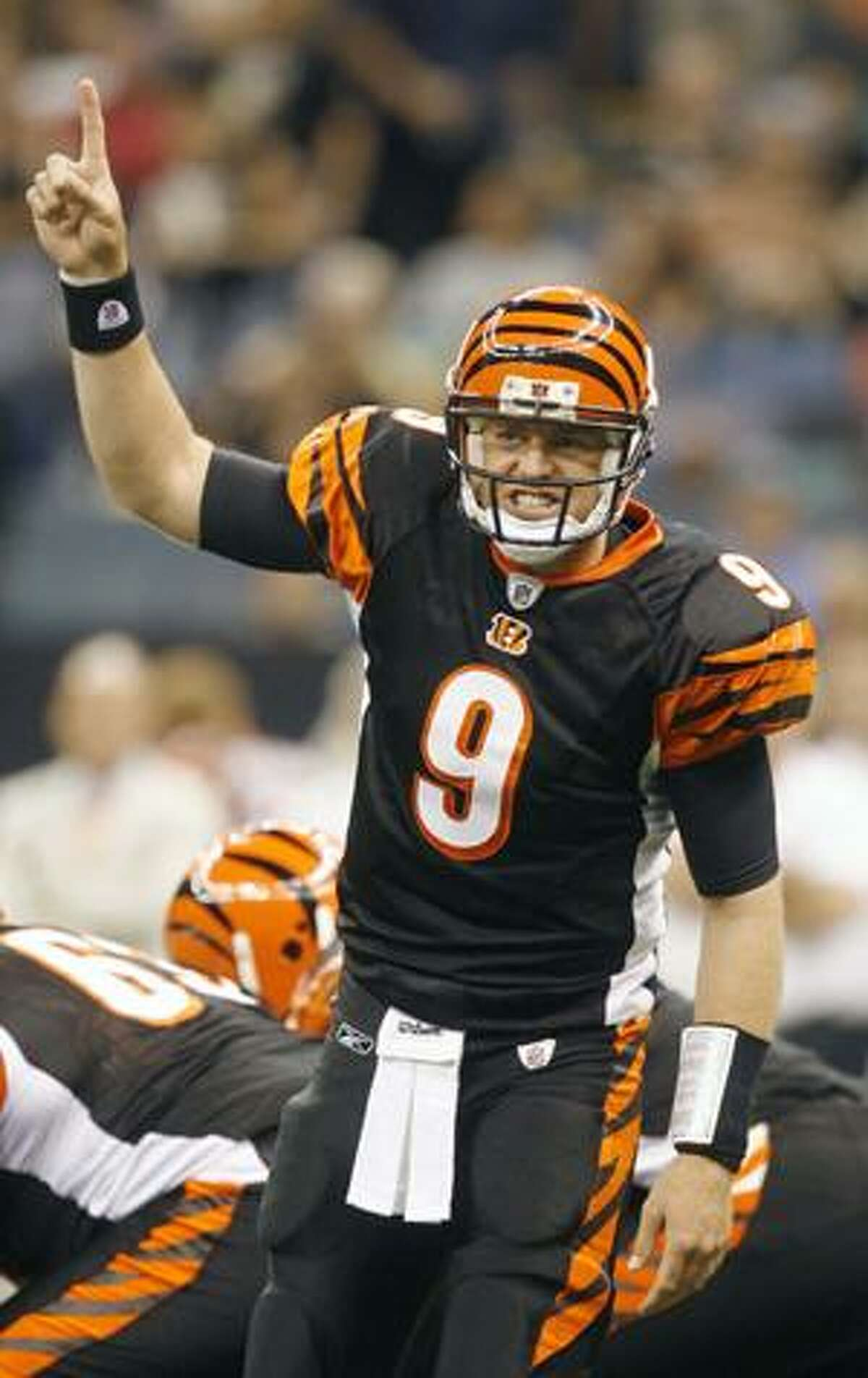 AP Cincinnati Bengals quarterback Carson Palmer (9) calls a play against the New Orleans Saints in the first half of their NFL preseason game in New Orleans on Aug. 14.