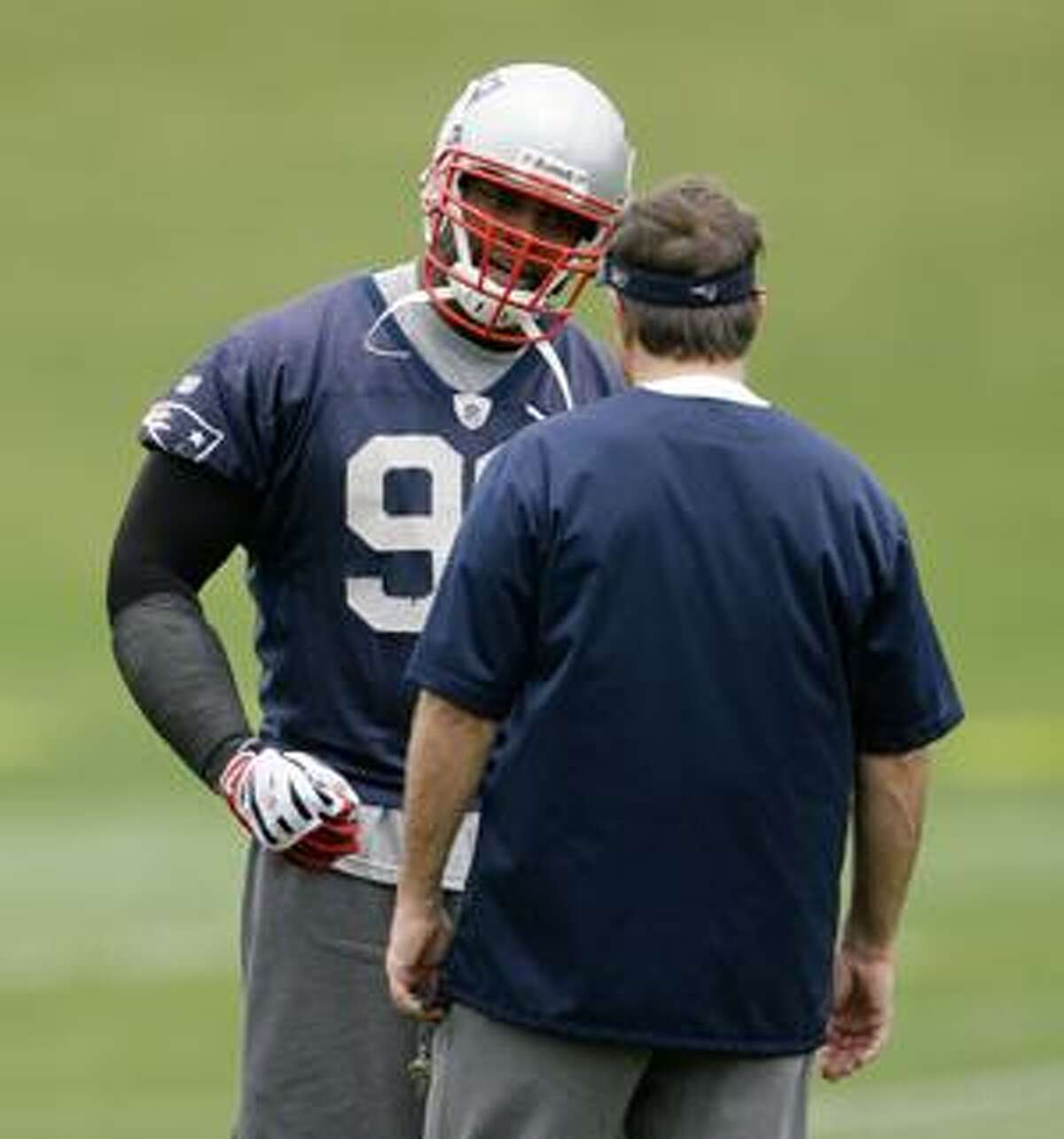 FILE - This june 2, 2009, file photo shows New England Patriots linebacker Adalius Thomas (96) talking with New England Patriots head coach Bill Belichick during practice at the team's football facility in Foxborough, Mass. The Patriots on Monday, April 26, 2010, released former Pro Bowl linebacker Adalius Thomas, who joined the team as a high-profile free agent in 2007, but fell into disfavor with coach Bill Belichick last season. (AP Photo/Stephan Savoia, File)