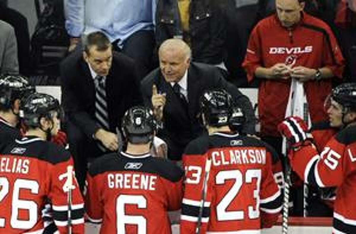 FILE - This April 14, 2010, file photo shows New Jersey Devils coach Jacques Lemaire gesturing while talking to his team during the third period of an NHL first-round playoff hockey game against the Philadelphia Flyers, in Newark, N.J. Lemaire has retired following his team's first-round playoff elimination for the third straight year. Lemaire made the surprising announcement Monday, April 26, 2010.(AP Photo/Bill Kostroun, File)