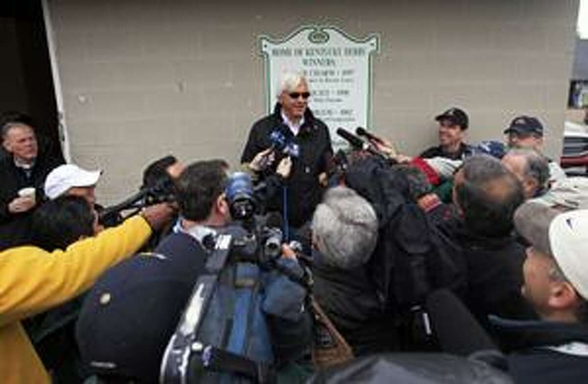 Kentucky Derby hopeful Lookin at Lucky trainer Bob Baffert talks to reporters at Churchill Downs Monday, April 26, 2010, in Louisville, Ky. (AP Photo/Charlie Riedel)