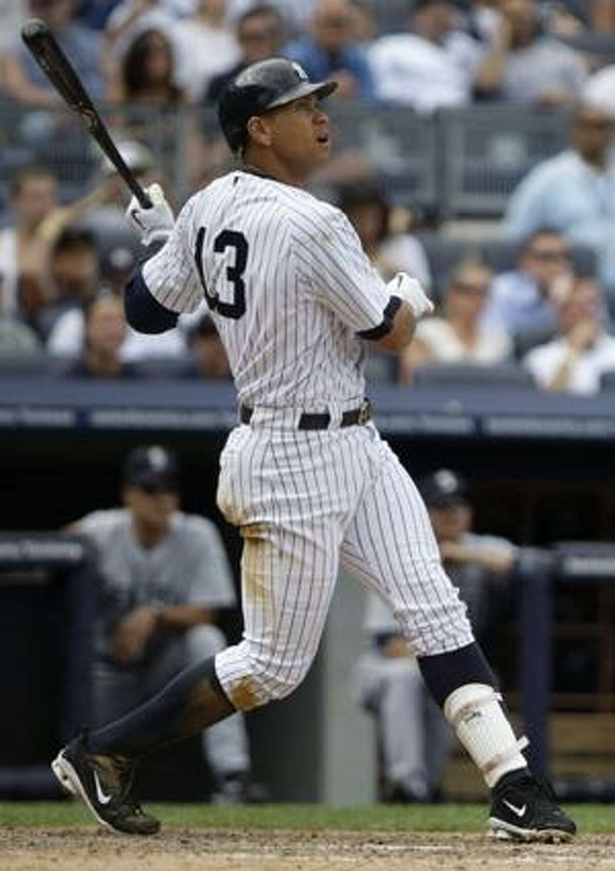 AP New York Yankees third baseman Alex Rodriguez hits a two-run home run during the eighth inning of Thursday's game against the Seattle Mariners in New York. The Yankees won the game 4-2.