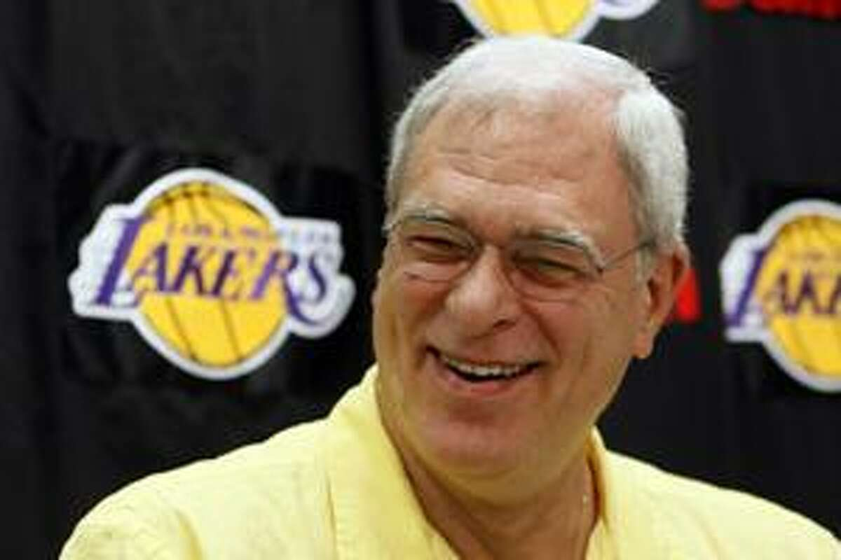 AP In this June 23 file photo, Los Angeles Lakers head coach Phil Jackson talks to reporters during exit interviews at the Lakers' basketball practice facility in El Segundo, Calif. Jackson will return next season, putting off retirement for at least another year to chase his 12th NBA championship. Jackson made the announcement on Thursday in a news release.